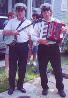 Musician on right holds a piano-accordion (on left a )