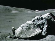 astronaut  standing next to boulder at Taurus-Littrow during third EVA
