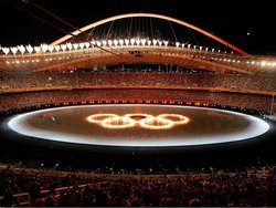 The 2004 Summer Olympics  was held on . As part of the theatrics, the  are seen burning in a pool of water.
