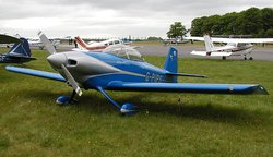 A general aviation scene at Kemble airfield, England. The aircraft in the foreground is a