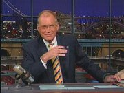 Letterman behind the desk at The Late Show.