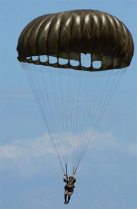 An American Paratrooper using a T-10C series 'round' parachute