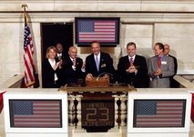 U.S.   rings the opening bell at the NYSE on April 23, 2003. Former chairman  can also be seen in this picture.