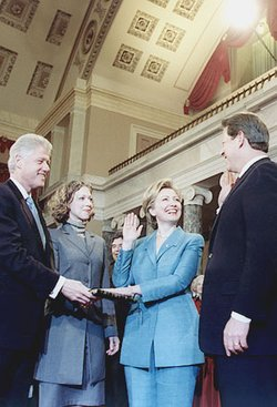 Hillary Clinton is sworn in as a U.S. Senator by Vice President Gore as Bill and  observe.