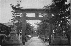 Gateway to Shinto shrine with torii gate