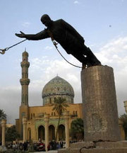 U.S. troops topple a giant statue of Saddam in Baghdad, following the capture of the city in April.