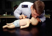 CPR demonstrated on a infant dummy