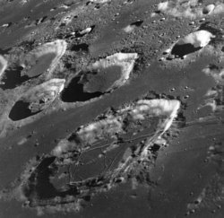 A portion of the lunar near side. The large crater in the bottom half of the photo is .
