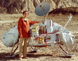 Sagan with a model of the  probes which would land on .