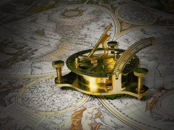 Gold sundial on a map