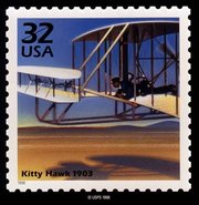 "USPS stamp depicting the ""first flight."""
